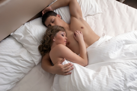 naked couple: Portrait of young couple sleep in hotel bed