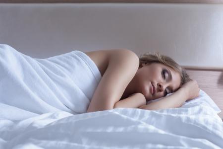 Portrait of pretty woman sleeping in bedroom Stock Photo