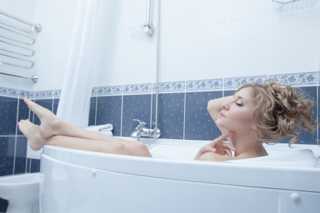Full length portrait of young blonde woman lying in bath Stock Photo - 16987936
