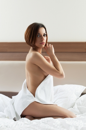 woman towel: cute young brunette woman wear towel and relax in bed Stock Photo