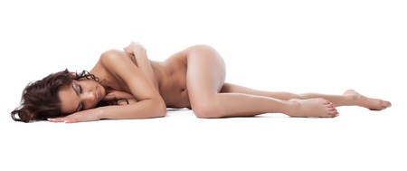 woman naked body: Beautiful bare brunette woman lay isolated on white