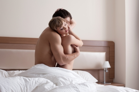 nude in bed: Young beauty Couple making morning love in bedroom
