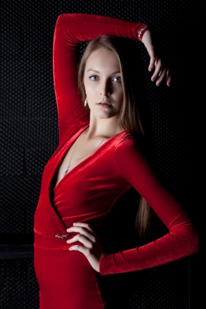 Portrait of beautiful young woman in red dress in dark Stock Photo - 17156571