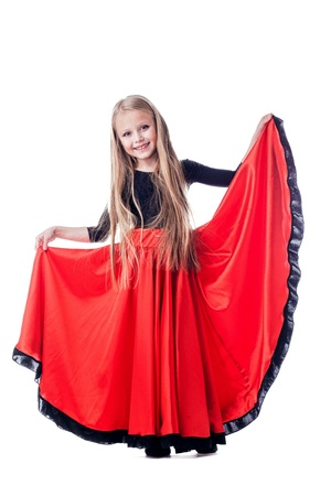 Full length portrait of little girl performing hispanic dance  Isolated on white photo