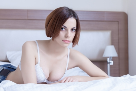thirty: Portrait of beautiful woman lying on bed