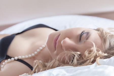 Portrait of beautiful young blonde woman sleeping photo