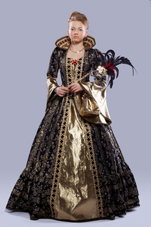 elizabethan: Full length portrait of young girl in carnival costume middle age