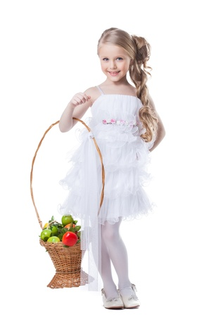 10s: Full length portrait of pretty little girl with fruits  Isolated on white Stock Photo
