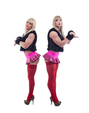 showman: Full length portrait of two transvestites in white go-go  wigs  Isolated on white Stock Photo