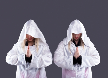 showman: Studio portrait of two transvestites in white cloaks Stock Photo