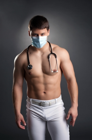 Sexy dancer in doctor costume with stethoscope  Studio portrait