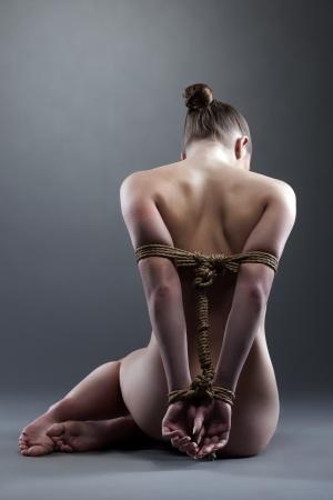 Full length portrait of woman posing with shibari in studio Stock Photo - 17597027