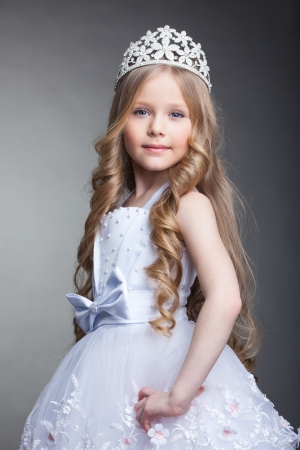 Studio portrait of pretty little girl in tiara photo