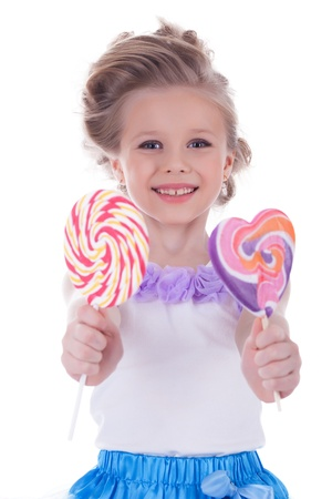 10s: Little girl offer to camera two lollipops  Isolated on white Stock Photo