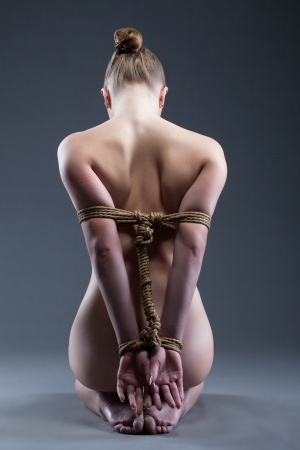 nude back: Studio portarit of young woman with shibari   Rear view Stock Photo