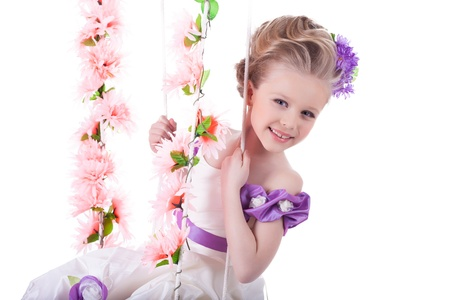 Portrait of beautiful girl on floral swing, on white background photo