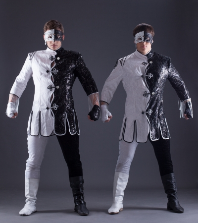 two young guys in theater costumes, on gray background photo