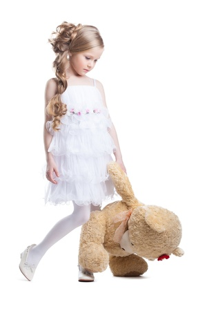 cute girl with teddy bear: Lovely little girl with plush toy isolated on white