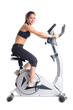 Brunette woman on bike  exerciser  Isolated on white photo