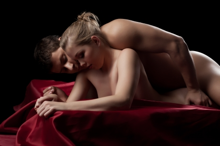 sex couple: Studio portrait of couple having sex in silk sheet