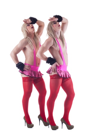 Young crossdressers posing in studio on white background photo