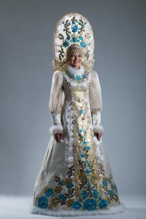 kokoshnik: Smiling young girl posing in Russian traditional costume