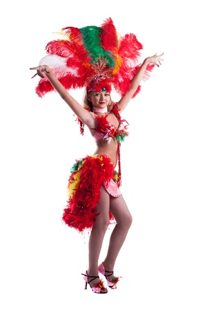 Attractive samba dancer posing in studio, isolated on white Foto de archivo