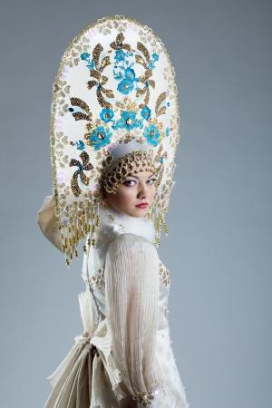 kokoshnik: Image of beautiful Russian girl in kokoshnik, on blue background