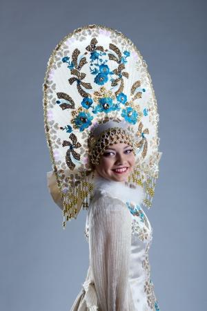 kokoshnik: Portrait of smiling young woman in kokoshnik, on blue background