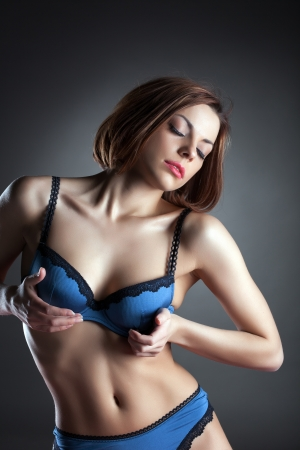 woman bra: Portrait of spectacular brunette in blue lingerie, close-up Stock Photo