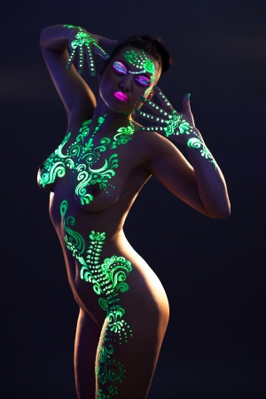 Image of sensual woman with UV glowing makeup, close-up