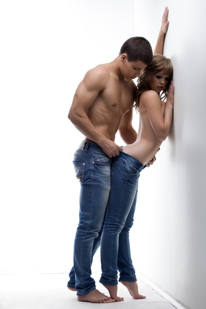 erotic sex: Passionate couple having foreplay in studio, on white background Stock Photo