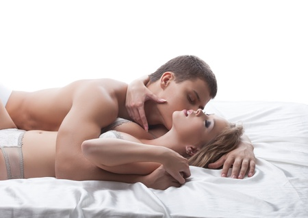 adult sex: Sensual couple posing kissing in bed, on white background