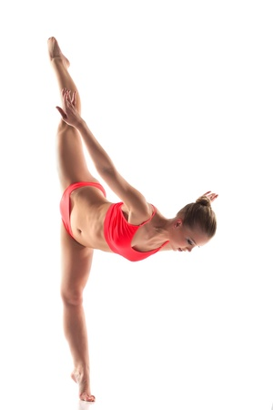 motouz: Urostlý Mladá žena dělá gymnastiku rozkoly, izolovaných na bílém Reklamní fotografie