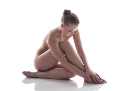nude sport: Charming naked girl isolated on white, close-up Stock Photo