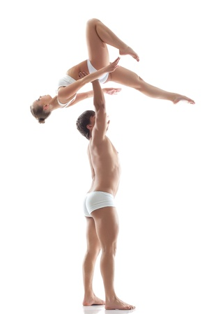 boy gymnast: Image of graceful acrobats - strong man holds girl, isolated on white
