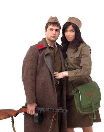 Attractive man and woman posing in khaki, isolated on white