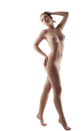 Beautiful naked woman posing in studio, isolated on white background