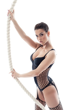 woman rope: Portrait of hot brunette posing with rope, close-up Stock Photo