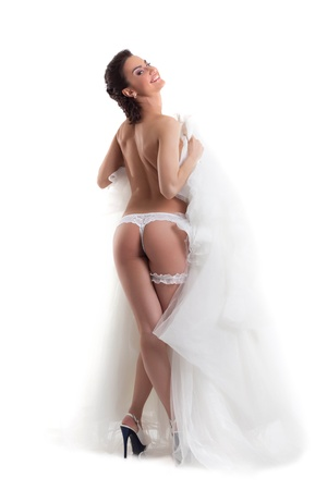 Image of young beautiful bride posing in lingerie, isolated on white photo