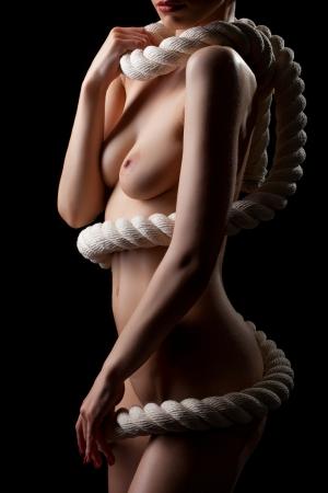 hot breast: Изображение тела Голая женщина, с веревкой, изолированных на черном Фото со стока