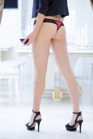 booty: Image of womans elastic booty in red panties, close-up