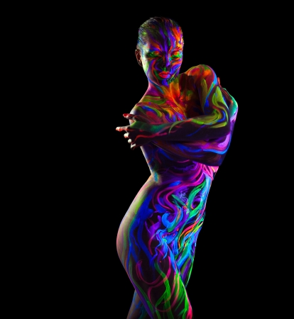 naked female body: Naked colorful woman with glowing make-up posing isolated on black