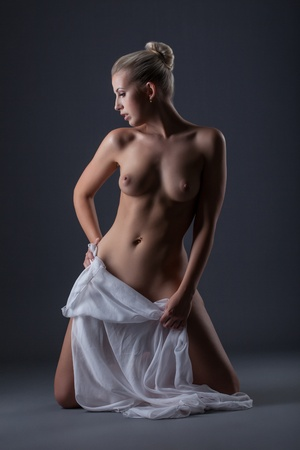 Sensual naked woman posing with white cloth, close-up