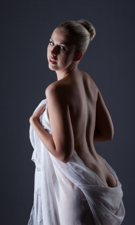 Beautiful slender model posing back to camera, close-up photo