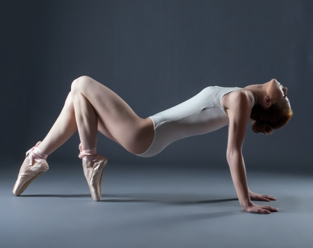 Portrait of emotional graceful dancer on pointes, close-up photo