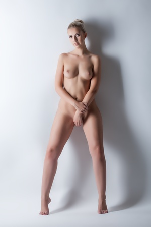 beautiful nude women: Image of lovely slim blonde posing nude in studio, close-up