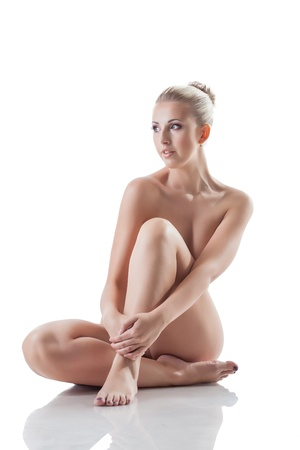 Beautiful naked blonde isolated on white background photo