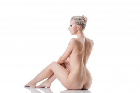 Graceful naked blonde isolated on white background photo
