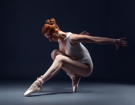 slender woman: Graceful slender ballerina dancing in studio, close-up